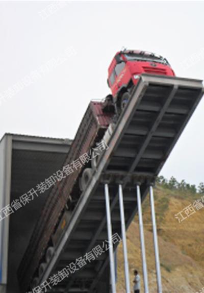 液压翻板卸车机分为固定式和移动式两种